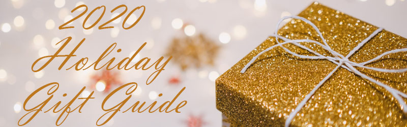 present box with gold glitter lid and white twine bow next to 2020 holiday gift guide in gold letters