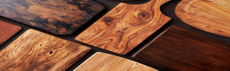close up of rows of wooden cutting boards of different grains and stains