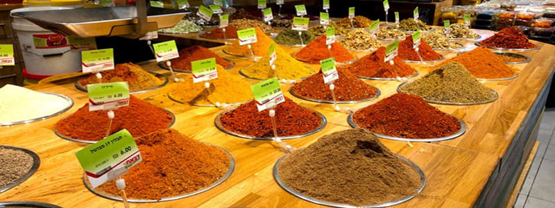 market stall with piles of various spices
